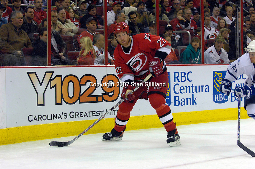 Carolina Hurricanes' defenseman Mike Commodore passes to a teammate during a hockey game with the Toronto Maple Leafs Tuesday, Jan. 30, 2007 at the RBC Center in Raleigh. The Leafs won 4-1.