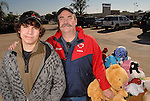 Scott Briggs and his son Andrew,16, stand with toys collected by girl scouts in a toy drive Saturday Dec. 05,2009. Briggs' daughter Julia died earlier this year and her fellow girl scouts continued her silver star project to collect stuffed animals HPD to distrubute to kids. (Dave Rossman/For the Chronicle)