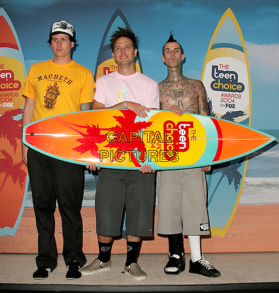 BLINK 182.The 2004 Teen Choice Awards held at The Universal Ampitheatre in Universal City, California.August 8, 2004.full length, surf board, tattoos, cast, foot, music, band.www@capitalpictures.com.sales @capitalpictures.com.©Capital PIctures