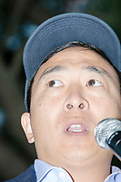 """Entrepreneur and Democratic presidential candidate Andrew Yang speaks to a large crowd in Cambridge Common near Harvard Square in Cambridge, Massachusetts, on Mon., September 16, 2019. Yang's unlikely presidential bid is centered on his idea for a """"Freedom dividend,"""" which would give USD$1000 per month to every adult in the United States. After appearing in three Democratic party debates, Yang has risen in polls from longshot candidate to within the top 10."""