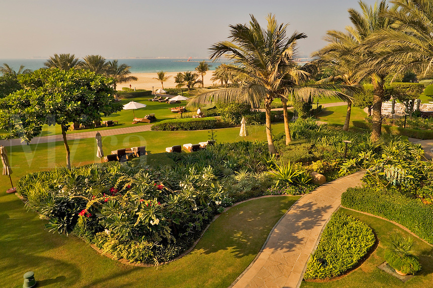 Dubai.  Gardens and beach at the Ritz Carlton Hotel at Jumeirah Beach..