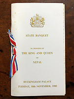 BNPS.co.uk (01202 558833)<br /> Pic: Charterhouse/BNPS<br /> <br /> The State Banquet for The King and Queen of Nepal in 1980<br /> <br /> The fascinating archive of a longstanding member of staff to the Royal family has emerged for sale.<br /> <br /> It features a selection of Royal Christmas cards, including one from 2019, as well as a slice of wedding cake and an order of service from Charles and Diana's wedding in 1981.<br /> <br /> The vendor, who wishes to remain anonymous, is also selling their Royal 'personal service' medal and the menu and seat plan for a state banquet in 1980.<br /> <br /> They worked at Buckingham Palace from the late 70s to the beginning of the 21st century, receiving Christmas cards every year since as a token of their service.<br /> <br /> The collection is being sold with Charterhouse Auctioneers, of Sherborne, Dorset. It is expected to fetch £1,500.