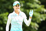 Lexi Thompson acknowledge the fans on the 11th green at the LPGA Championship 2014 Sponsored By Wegmans at Monroe Golf Club in Pittsford, New York on August 13, 2014