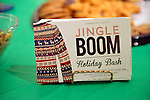 Huntington, New York, USA. February 20, 2014. The festive Jingle Boom Holiday Bash has entertainment and food, at the Main Street Gallery of Huntington Arts Council. Postcards decorated with an ugly winter sweater were on the refreshment table, and prizes were given to people wearing the most creative or Ugly Sweaters. Sparkboom, an HAC project, provides events such as this geared to Gen-Y, 18-34 years of age, to address the 'brain drain' of creative young professionals of Long Island.