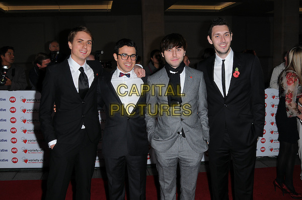 JOE THOMAS, SIMON BIRD, JAMES BUCKLEY & BLAKE HARRISON .The Co-operative Variety Club Showbiz Awards, Grosvenor House Hotel, Park Lane, London, England, UK, .14th November 2010. .half length black suit tie grey gray scarf white shirt the inbetweeners cast .CAP/CAS.©Bob Cass/Capital Pictures.