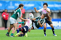 Larissa Lima of Portugal offloads the ball after being tackled. FISU World University Championship Rugby Sevens Women's 3rd/4th Play-off between Portugal and Japan on July 9, 2016 at the Swansea University International Sports Village in Swansea, Wales. Photo by: Patrick Khachfe / Onside Images