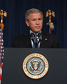 United States President George W. Bush makes a statement after meeting with Members of the Commission on the Intelligence Capabilities of the United States Regarding Weapons of Mass Destruction in the Cabinet Room at the White House in Washington, D.C. on March 31, 2005. In his remarks, the President also expressed sorrow at the death of Terri Schaivo.<br /> Credit: Ron Sachs -CNP