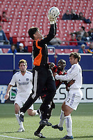 """The EarthQuakes' goalkeeper Pat Onstad comes off his line to take a cross away from Abdoulaye """"Abbe"""" Ibrahim of the MetroStars as Eddie Robinson defends and Danny O'Rourke watches. The San Jose EarthQuakes defeated the MetroStars 1 - 0 at Giant's Stadium, East Rutherford, NJ, on Saturday May 7, 2005."""