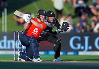 England captain Eoin Morgan bats as New Zealand's Tim Seifert looks on during the 4th Twenty20 International cricket match between NZ Black Caps and England at McLean Park in Napier, New Zealand on Friday, 8 November 2019. Photo: Dave Lintott / lintottphoto.co.nz