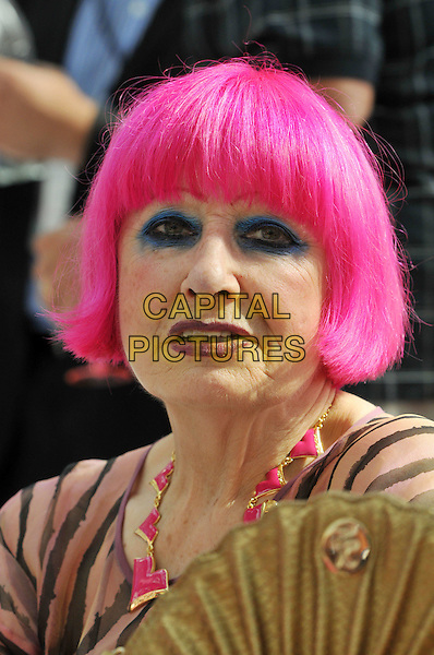 Afternoon Tea with Zandra Rhodes.  British fashion designer hosts afternoon tea event and Q&A for press to launch her new handbag collection at Pure London, London Olympia, London, England..August 20th, 2012.headshot portrait pink hair dyed necklace blue eyeliner make-up beauty sheer stripe .CAP/BF.©Bob Fidgeon/Capital Pictures.