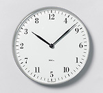 Askew Clock; ca. 1989; Designed by M & Co. (New York, New York, USA); Nickel-brushed steel, plastic, quartz movement; 3.2 × 23.5 cm (1 1/4 × 9 1/4 in.); Gift of Tibor Kalman/ M & Co., 1993-151-29-1