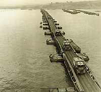 BNPS.co.uk (01202 558833)<br /> Pic: MitchellsAuctionHouse/BNPS<br /> <br /> PICTURED: Ambulances using one of the piers at Arromanches off the Normandy coast<br /> <br /> The fascinating archive of one of the engineers who designed the Mulberry Harbours which were installed off the Normandy coast following the D-Day landings has come to light.<br /> <br /> Colonel Vassal Charles Steer-Webster OBE helped create the giant, floating artificial harbours which protected anchored supply ships from German attacks.<br /> <br /> They were built in the dry docks on The Thames and Clyde and pulled across the channel by tugs before being hastily assembled.<br /> <br /> Col Steer-Webster was in almost daily contact with Churchill during their development ahead of June 6, 1944. Now, his personal effects, including a letter of thanks from Winston Churchill, are being sold by his nephew with Mitchells Auctioneers, of Cockermouth, Cumbria. <br /> <br /> The archive, which is expected to fetch £15,000, also features 150 photos showing Mulberry B's construction and use, as well as his medals.