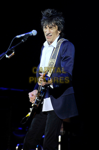 Ronnie Wood .performing live in concert as part of the Bluesfest 2012, Hammersmith Apollo, London, England, UK, 30th June 2012..music concert gig on stage live half length blue jacket playing guitar microphone white shirt blazer .CAP/MAR.© Martin Harris/Capital Pictures.
