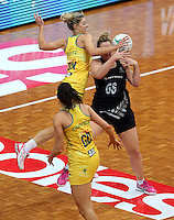 13.10.2013 Silver Fern Cathrine Latu and Australian Diamond Laura Geitz in action during the Silver Ferns V Australian Diamonds Netball Series played at the AIS Arena in Canberra Australia. Mandatory Photo Credit ©Michael Bradley.