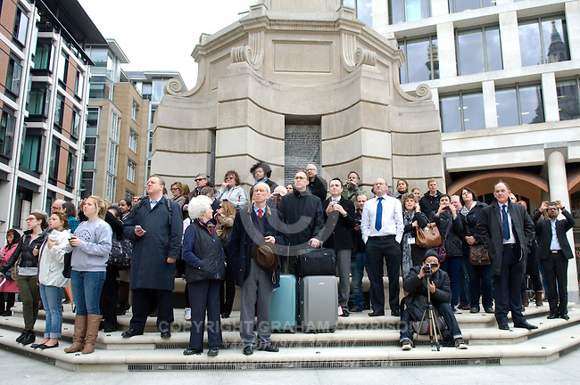 People stand on the steps of the Paternoster Square Column near St Paul's Cathederal to watch the funeral of Margaret Thatcher,London 17 April 2013.<br /> <br /> Margaret Thatcher (1925-2013) was a radical Conservative politician and British Prime Minister from 1979 to 1992.  <br /> <br /> PHOTO COPYRIGHT GRAHAM HARRISON graham@grahamharrison.com<br /> +44 (0) 7974 357 117<br /> Moral rights asserted.