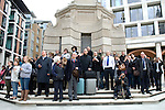 People stand on the steps of the Paternoster Square Column near St Paul's Cathederal to watch the funeral of Margaret Thatcher,London 17 April 2013.<br />