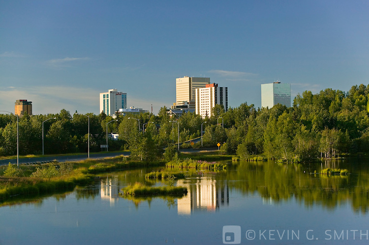The Anchorage city skyline seen accros West Chester Lagoon, summer, Anchorage, Alaska