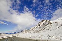The Trans Alaska oil pipeline stretches across the snow covered tundra, James Dalton Highway, Brooks Range, Arctic, Alaska.