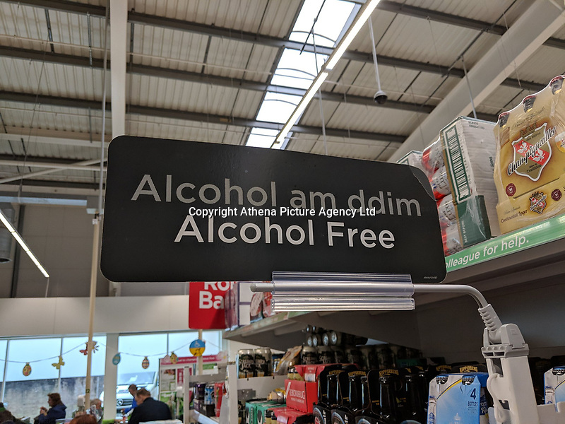 "Pictured: The ""Free Alcohol"" sign in the ASDA store in Cwmbran, Wales, UK.<br /> Re: A sign in the Asda super market store in Cwmbran, Wales, for the alcohol-free section was incorrectly translated to ""free alcohol"" in Welsh.<br /> Guto Aaron, who spotted the sign, wrote on Twitter: ""Get yourself to Asda, according to their dodgy Welsh translations they are giving away free alcohol.""<br /> Asda have said it was changing the sign.<br /> The sign - which should read di-alcohol - in fact says alcohol am ddim, which means free alcohol.<br /> An Asda spokesman said: ""Mae'n ddrwg gennym (we are sorry). We would like to thank our eagle-eyed customers for spotting this mistake. We hold our hands up and will be changing the signs in our Cwmbran store straight away.""<br /> The supermarket confirmed there would not be free alcohol in stores this weekend."