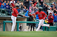 Rochester Red Wings manager Joel Skinner (35) congratulates Tomas Telis (18) after hitting a home run during an International League game against the Charlotte Knights on June 16, 2019 at Frontier Field in Rochester, New York.  Rochester defeated Charlotte 11-5 in the first game of a doubleheader that was a continuation of a game postponed the day prior due to inclement weather.  (Mike Janes/Four Seam Images)