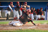 Batavia Muckdogs shortstop Micah Brown (55) slides home safely during a game against the Tri-City ValleyCats on July 14, 2017 at Dwyer Stadium in Batavia, New York.  Batavia defeated Tri-City 8-4.  (Mike Janes/Four Seam Images)