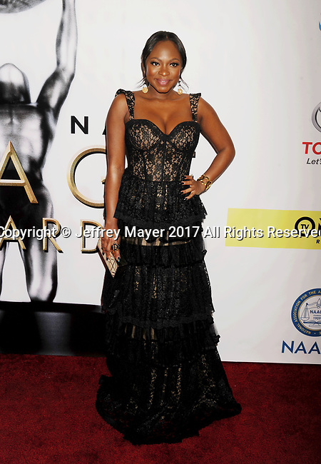 PASADENA, CA - FEBRUARY 11: Actress Naturi Naughton arrives at the 48th NAACP Image Awards at Pasadena Civic Auditorium on February 11, 2017 in Pasadena, California.