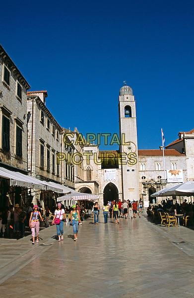 Looking along Stradun to Bell tower (Gradski Zvonik), Dubrovnik, Dalmatian Coast, Croatia, Former Yugoslavia