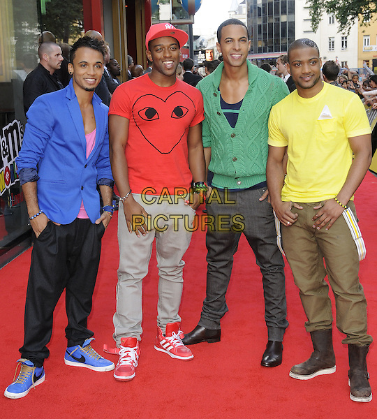"JLS (ASTON MERRYGOLD, ORITSE WILLIAMS, MARVIN HUMES & JONATHAN ""JB"" GILL).Official opening of the M&M's World London store, Leicester Square, London, England..July 6th, 2011.full length blue blue green cardigan band group red yellow heart jacket jeans denim hat.CAP/CAN.©Can Nguyen/Capital Pictures."