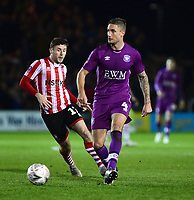 Carlisle United's Gary Liddle under pressure from Lincoln City's Shay McCartan<br /> <br /> Photographer Andrew Vaughan/CameraSport<br /> <br /> The Emirates FA Cup Second Round - Lincoln City v Carlisle United - Saturday 1st December 2018 - Sincil Bank - Lincoln<br />  <br /> World Copyright © 2018 CameraSport. All rights reserved. 43 Linden Ave. Countesthorpe. Leicester. England. LE8 5PG - Tel: +44 (0) 116 277 4147 - admin@camerasport.com - www.camerasport.com