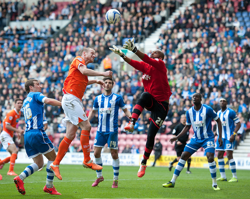 Wigan Athletic's goalkeeper Ali Al-Habsi collects the ball from Blackpool's Neil Bishop<br /> <br /> Photo by Stephen White/CameraSport<br /> <br /> Football - The Football League Sky Bet Championship - Wigan Athletic v Blackpool - Saturday 26th April 2014 - DW stadium - Wigan<br /> <br /> &copy; CameraSport - 43 Linden Ave. Countesthorpe. Leicester. England. LE8 5PG - Tel: +44 (0) 116 277 4147 - admin@camerasport.com - www.camerasport.com