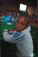 Seven-year-old Maimlina Chepkemoi in class. Rhonda slum, Nakuru, Kenya.