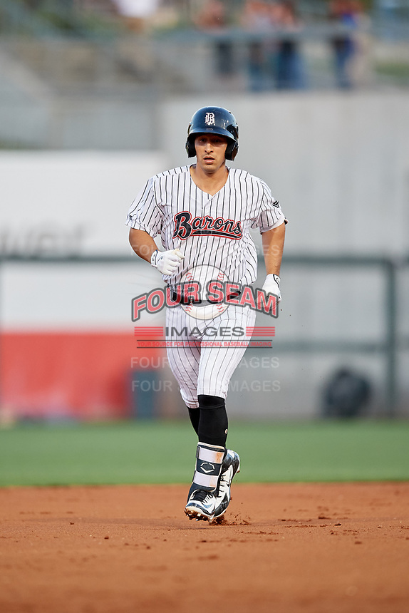 Birmingham Barons designated hitter Seby Zavala (19) rounds the bases after hitting a home run in the bottom of the first inning during a game against the Pensacola Blue Wahoos on May 8, 2018 at Regions FIeld in Birmingham, Alabama.  Birmingham defeated Pensacola 5-2.  (Mike Janes/Four Seam Images)