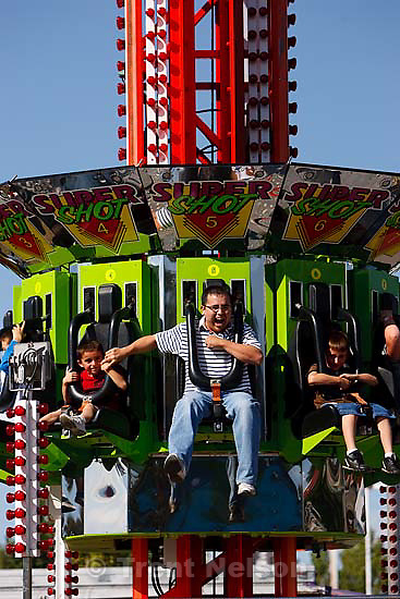 Nic Montoya (center) screams and reaches out for his son Tony's hand as the carnival ride Super Shot drops them from over 100 feet in the air at the Utah State Fair Saturday September 19, 2009 in Salt Lake City. At right is another of Nic's sons, Dominic Montoya.
