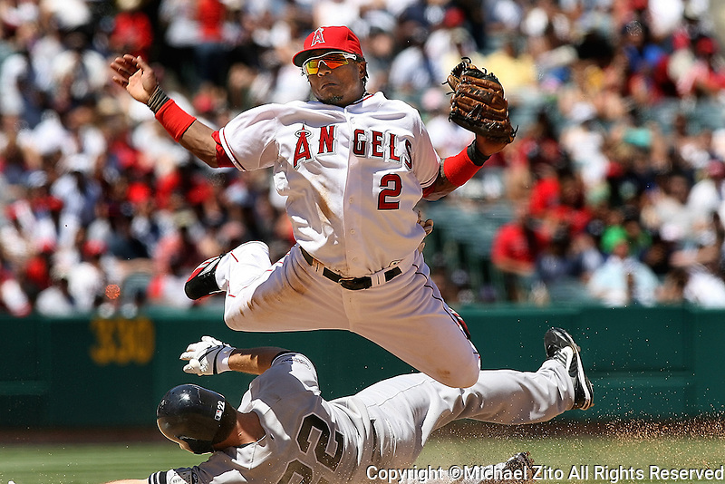 08/10/08 Anaheim, CA: New York Yankee LF Xavier Nady #22 slides hard in to Los Angeles Angels SS Erick Aybar #2 during an MLB game at Angel Stadium. The Angels defeated the Yankees 4-3
