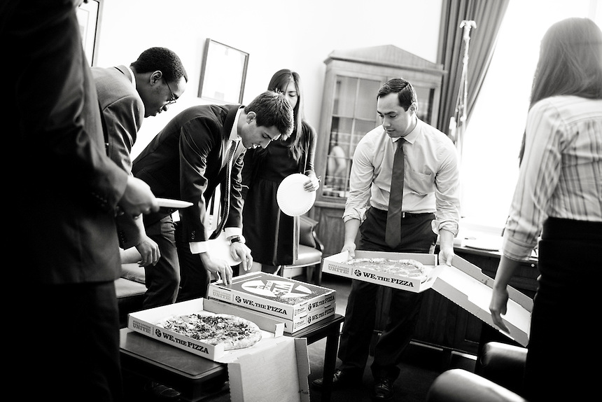 Freshman  Congressman, United States Representative Joaquin Castro from San Antonio, Texas gathers with his departing interns over pizza at his office in the Cannon Building in Washington, DC on July 24, 2013. CREDIT: Lance Rosenfield/Prime