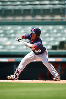 GCL Twins left fielder Lean Marrero (90) lays down a bunt during a game against the GCL Orioles on August 11, 2016 at the Ed Smith Stadium in Sarasota, Florida.  GCL Twins defeated GCL Orioles 4-3.  (Mike Janes/Four Seam Images)