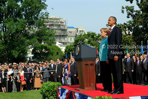 United States President Barack Obama, right, and Angela Merkel, Germany's chancellor, review a military honor guard during a welcoming ceremony on the South Lawn of the White House in Washington, D.C., U.S., on Tuesday, June 7, 2011. .Credit: Andrew Harrer / Pool via CNP