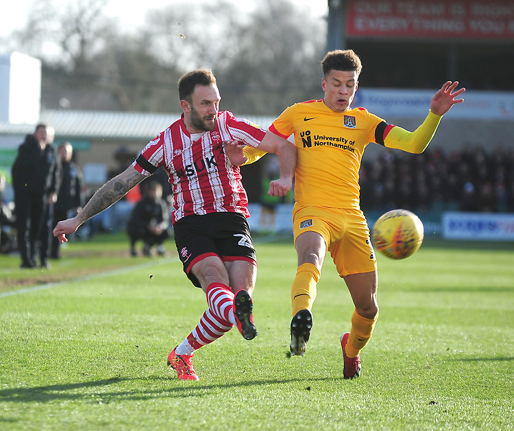 Lincoln City's Neal Eardley battles with Northampton Town's Shaun McWilliams<br /> <br /> Photographer Andrew Vaughan/CameraSport<br /> <br /> The EFL Sky Bet League Two - Lincoln City v Northampton Town - Saturday 9th February 2019 - Sincil Bank - Lincoln<br /> <br /> World Copyright &copy; 2019 CameraSport. All rights reserved. 43 Linden Ave. Countesthorpe. Leicester. England. LE8 5PG - Tel: +44 (0) 116 277 4147 - admin@camerasport.com - www.camerasport.com