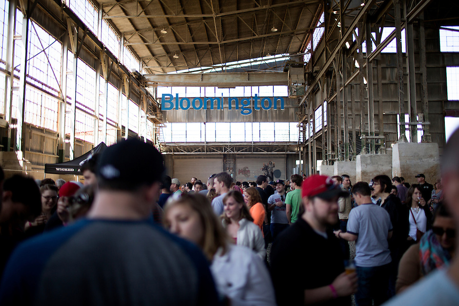 Patrons make their way to various brewery stops during the 5th Annual Bloomington Craft Beer Festival on Saturday, April 11, 2015, at Woolery Mill in Bloomington. (Photo by James Brosher)