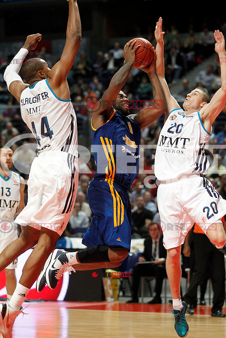 Real Madrid's Marcus Slaughter (l) and Jaycee Carroll (r) and BC Khimki MR's Kelvin Rivers during Euroleague 2012/2013 match.November 23,2012. (ALTERPHOTOS/Acero) /NortePhoto