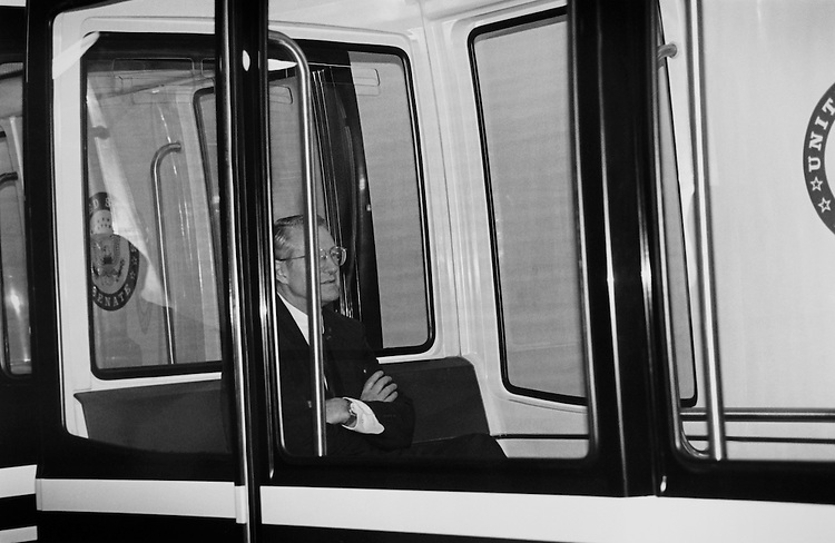 "Sen. George Hanks ""Hank"" Brown, R-Colo., stranded on Senator subway between the Capitol and Drikson Building.  He and another man get out on their own instead of waiting for the subway to start up again. May 8, 1995 (Photo by Maureen Keating/CQ Roll Call)"