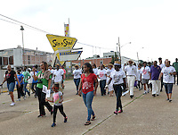 "Civil Rights icon James Meredith, 83,wearing white shirt, pants and a hat, on right, walks from the Smith Robertson museum in downtown Jackson MS. to the State Capitol to commemorate the 50th Anniversary of his historic Walk Against Fear in 1966. Meredith was shot on the second day of his walk in 1966 in Hernando MS and Dr. Martin Luther King and other major civil rights leaders of the time continued Meredith's March from Memphis to Jackson which ended at he Mississippi State Capitol on June 26, 1966 with 15,000 marchers. The Meredith March was the largest civil rights march ever in the state of Mississippi.  The Smith Robertson Museum has an exhibit all about Meredith's March called ""Am I or Am I Not  A Citizen."" and Meredith spoke and signed books at the museum before the walk to the state capitol. Photo©Suzi Altman"
