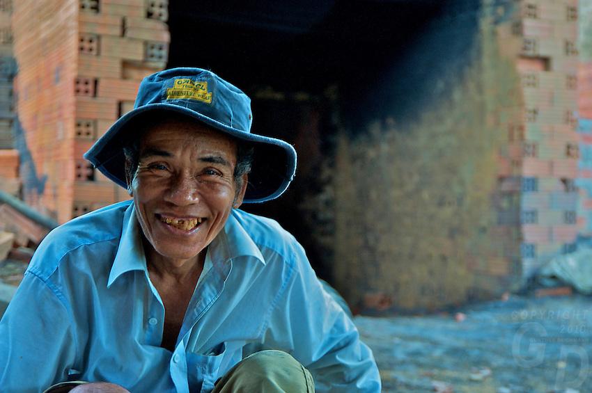Portrait of a local khmer man  in rural area near a brick kiln, Battambang Cambodia