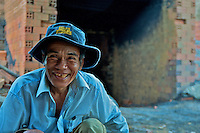 Portrait of a local khmer man  in rural area near a brick kiln, Battambang Cambodia