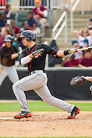 Adrian Marin (6) of the Delmarva Shorebirds follows through on his swing against the Kannapolis Intimidators at CMC-Northeast Stadium on April 17, 2013 in Kannapolis, North Carolina.  The Shorebirds defeated the Intimidators 9-4.  (Brian Westerholt/Four Seam Images)