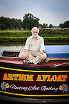 "© Joel Goodman - 07973 332324 . 23 August 2013 . Barge on Bridgewater Canal , moored in Oughtrington , Cheshire , UK . Gallery curator DAVE CLARKE (67) (from Altrincham) (correct) on a barge which he has bought and adapted to form a floating art gallery called "" Artism "" , exhibiting the work of autistic artists . Photo credit : Joel Goodman"