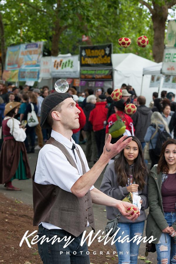 Juggler and crystal ball street performer, Northwest Folklife Festival 2016, Seattle Center, Washington, USA.