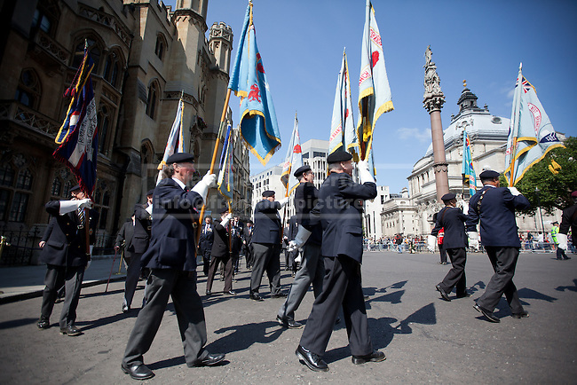 11/07/2013. London, UK. British veterans of the Korean War march to a service held at Westminster Abbey in London today (11/07/2013). The parade and service held to commemorate the 60th Anniversary of the end of the Korean War, often known as the 'Forgotten War', which saw a United Nations force of many nations fight against North Korean and Chinese forces trying to invade South Korea. Photo credit: Matt Cetti-Roberts