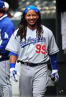 25 April 2009: Dodgers outfielder Manny Ramirez in the dugout prior to a game between the Los Angeles Dodgers and the Colorado Rockies at Coors Field in Denver, Colorado. *****For Editorial Use Only*****