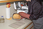 Removing fresh baked bread fro bread machine